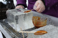 Maple Taffy cooling on ice blocks.