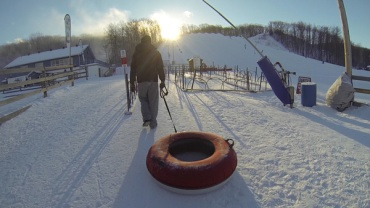 Winter-fun-with-Lets-Discover-ON---snowtubing-walking-uphill